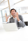Cheerful businessman asking for good luck Stock Photography