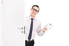 Cheerful businessman bringing toilet paper Royalty Free Stock Photo