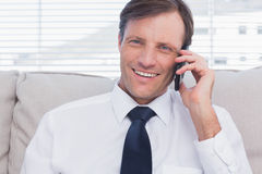 Cheerful businessman calling Stock Photo