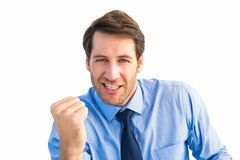 Cheerful businessman clenching fist looking at camera Stock Photo