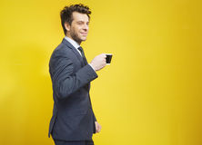 Cheerful businessman during the coffee break Stock Photos