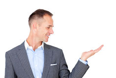 Cheerful businessman demonstrating Royalty Free Stock Image
