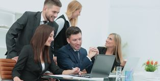 Successful busines team  in an modern office. Cheerful businessman discussing a new business project with the members of his team Royalty Free Stock Photography
