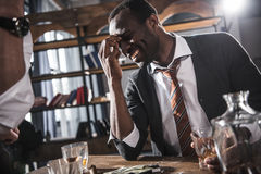 Cheerful businessman drinking alcohol after work Stock Images