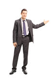 Cheerful businessman gesturing with his hand Stock Image