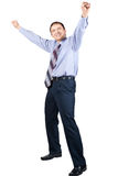 Cheerful businessman with hands raised in victory. Full length portrait of cheerful excitement businessman with hands raised in victory, over white background Stock Photography