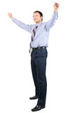 Cheerful businessman with hands raised in victory. Full length portrait of cheerful businessman with hands raised in victory, over white background Royalty Free Stock Images