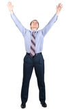 Cheerful businessman with hands raised in victory. Full length portrait of cheerful businessman with hands raised in victory, over white background Royalty Free Stock Photography