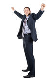 Cheerful businessman with hands raised in victory. Full length portrait of cheerful businessman with hands raised in victory, over white background Royalty Free Stock Image