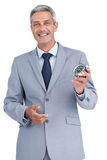 Cheerful businessman holding alarm clock Stock Photos
