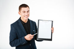Cheerful businessman holding blank clipboard Royalty Free Stock Photography