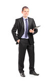 Cheerful businessman holding a clipboard Stock Photos