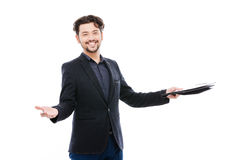 Cheerful businessman holding clipboard Stock Photo