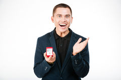 Cheerful businessman holding engagement ring Royalty Free Stock Photography