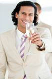 Cheerful businessman holding a glass of Champagne Stock Image