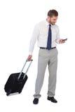 Cheerful businessman holding phone Stock Photo