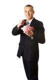Cheerful businessman holding piggybank Royalty Free Stock Images