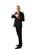 Cheerful businessman holding piggybank Royalty Free Stock Photography