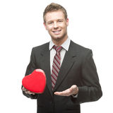 Cheerful businessman holding red heart Royalty Free Stock Photos