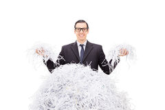 Cheerful businessman holding shredded paper Stock Photography