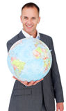 Cheerful businessman holding a terrestrial globe Royalty Free Stock Image