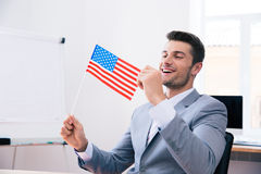 Cheerful businessman holding USA flag Royalty Free Stock Photography