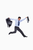 Cheerful businessman jumping Royalty Free Stock Images