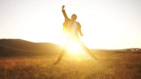 Cheerful businessman jumping stock footage