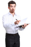 Cheerful businessman making notes Stock Image