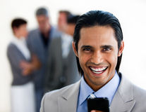 Cheerful businessman with mobile phone Stock Image