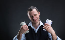 Cheerful businessman with money Royalty Free Stock Image