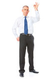 Cheerful businessman with ok sign Stock Image