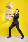 Cheerful businessman with paper boxes Royalty Free Stock Images