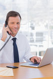 Cheerful businessman on the phone Stock Images