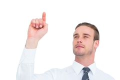 Cheerful businessman pointing with his finger Royalty Free Stock Photography