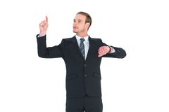 Cheerful businessman pointing up with finger Stock Photo