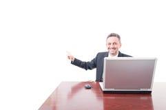 Cheerful businessman poiting on copyspace Stock Photos