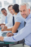 Cheerful businessman posing in the meeting room Stock Images