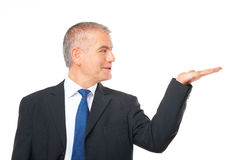 Cheerful businessman presenting Stock Images
