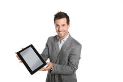 Cheerful businessman presenting a text or graphic on tablet Stock Image