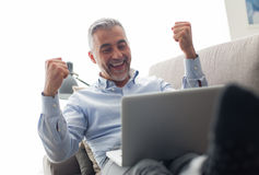 Cheerful businessman with raised fists Royalty Free Stock Images