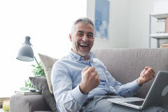 Cheerful businessman with raised fists Royalty Free Stock Photography