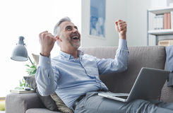 Cheerful businessman with raised fists Stock Image