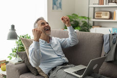 Cheerful businessman with raised fists Stock Photo