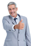 Cheerful businessman reaching for handshake Royalty Free Stock Photography
