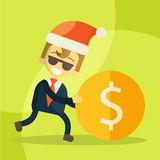 Cheerful businessman rolls coin, Christmas Stock Photo