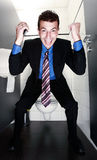 Cheerful businessman screaming in restroom Royalty Free Stock Photo