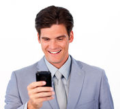 Cheerful businessman sending a message a newspaper Royalty Free Stock Images