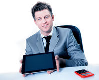 Cheerful businessman showing digital tablet Stock Photos