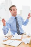Cheerful businessman showing documents Royalty Free Stock Photography